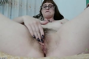 Thelma Sleaze loves to finger her hairy twat